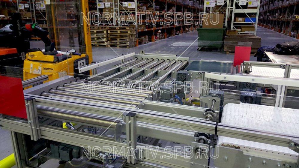 Автоматизированный конвейер на складе узел натяжения конвейера